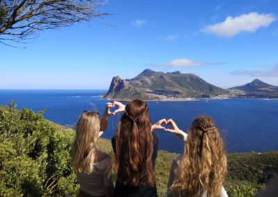 Tourists taking a picture at Chapmans Peak during Cape Point tour